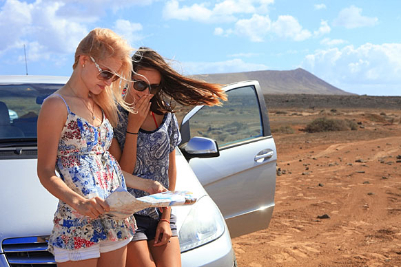 young women looking at a road map